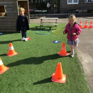 Keeping healthy by joining in with an obstacle course with a friend.