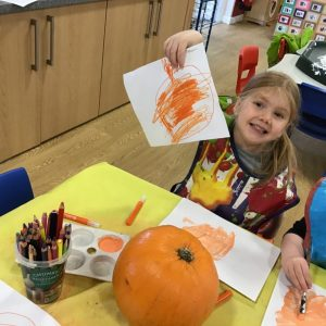 Drawing and painting pictures of a pumpkin.