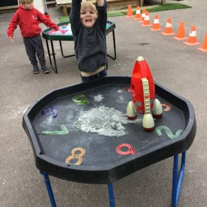 Exploring counting down to blast off the rocket in the space moondust tray.